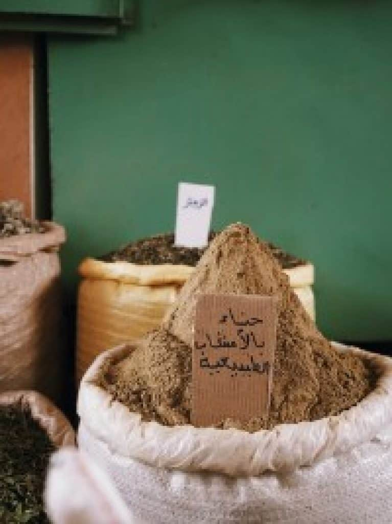 A picture of a bag of spices labeled in Arabic. When you learn Arabic, you can access a whole other part of the world and learn about Arabic culture and cuisine.
