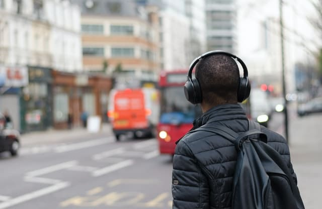 One of the best ways to learn Spanish is with podcast. This man is listening to a podcast while he walks in the street.