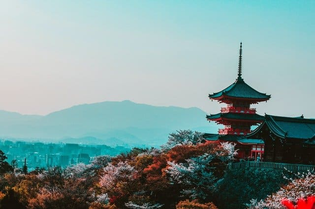 A temple in Japan overlooking the mountains. The best way to learn Japanese is to experience the culture of Japan!