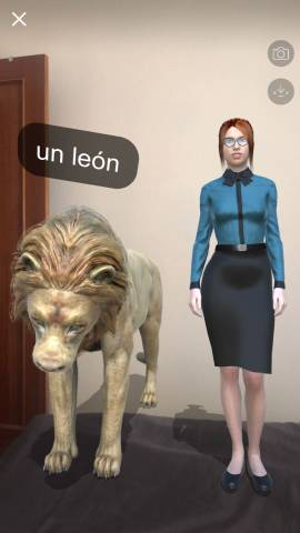 A screenshot of the Mondly AR app that shows a woman and a lion standing on my bed.