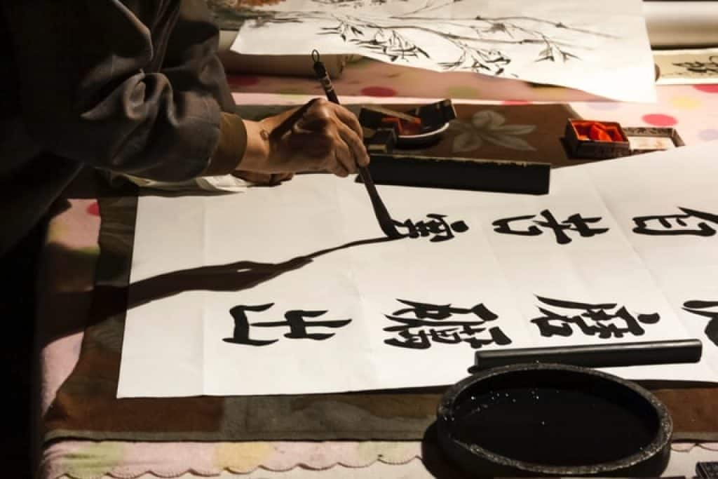 A man writing Chinese characters